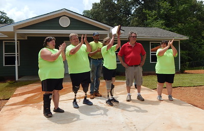 From left: Homeowners Carmen and Rodney Lott; house captain Barry Stuck of Pennsylvania; and Chattahoochee Fuller Center Project leaders Kim Roberts, Curt Johnson and Robin Pierre at the Lott house dedication in Valley, Alabama in June 2018. This was the CFCP's 40th new home build.