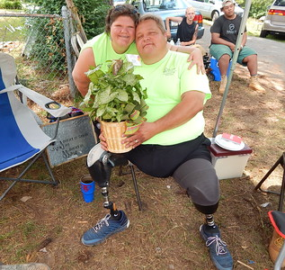 Carmen and Rodney Lott with a surprise houseplant given to them by their new next-door neighbors just before their house dedication in Valley, Alabama, in June 2018.