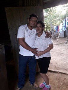 Jose and Gloria in the shack where they lived until recently.