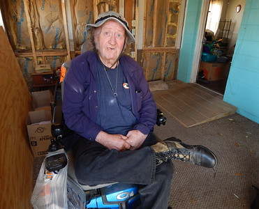 Vietnam Veteran Ray Moneymaker sits in his hurricane-damaged home in Panama City, a home that has been restored by the Fuller Center Disaster ReBuilders.