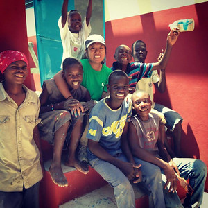 Fuller Center volunteer Amara Neng with children in Haiti.