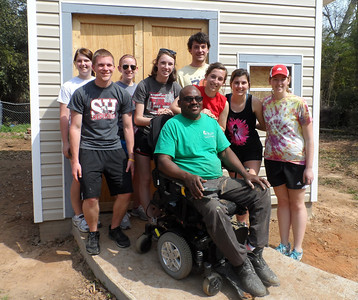 Ohio State students with homeowner Thad Harris.