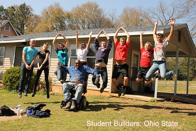 "PROGRAMS: Here you see Thad Harris ""jumping"" for joy along with some Student Builders from Ohio State University. His joy is contagious and getting to know the people in the communities they serv is very important to these kids."