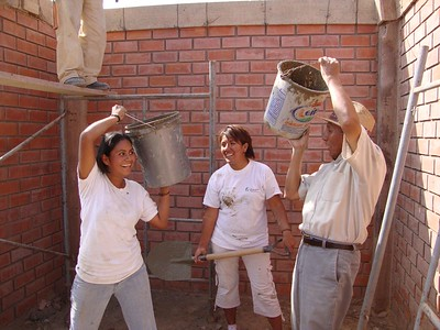 Zunimy's mother Ana (left) building her home.
