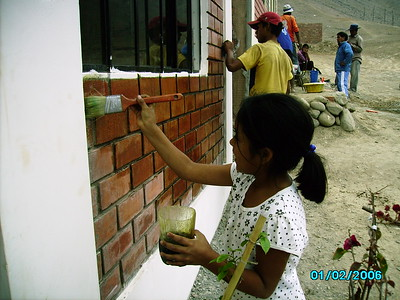 Zuinmy helping to build her home in La Florida, Peru