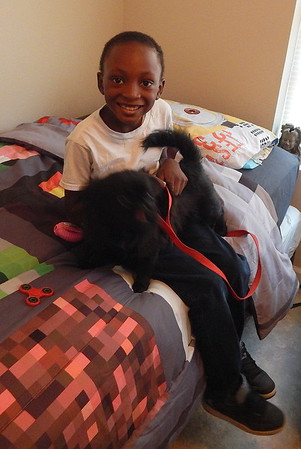 "Eight-year-old K'Hairi with his best friend, ""Blacky."""