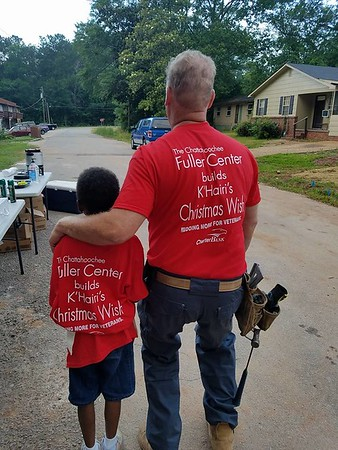 K'Hairi looks down the street in front of his new home with West Point, Ga. Mayor Steve Tramell, who worked every day for two weeks on the June 2017 build for K'Hairi and his mother, Carla Ross.
