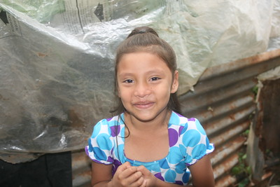 Sofia, then 6, outside the shack she lived in until 2017 brought her a safe new home.