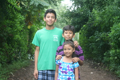 Sofia with older brothers Josué (left) and Ulises before moving into the new home in Ahuachapán.