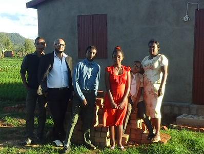 Nirina (red dress) and family in Madagascar