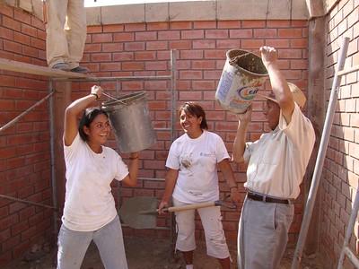 Ana Tarazona Ramos (left) building her home in La Florida, Peru, in 2009