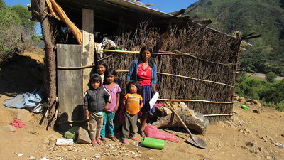 Too many families, such as this one in Bolivia, still live in unhealthy, dangerous shacks.