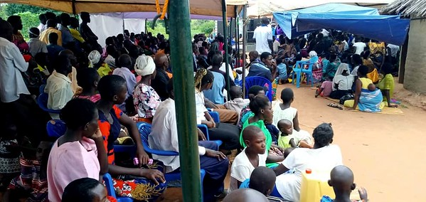 A large crowd showed up for the dedication of the Buyiinza family's home in Uganda.