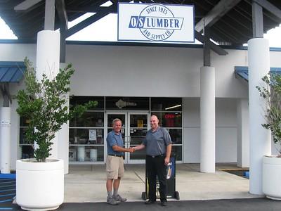 The Fuller Center Disaster ReBuilders' Bart Tucker with Ocean Springs Lumber manager Charlie Glenn