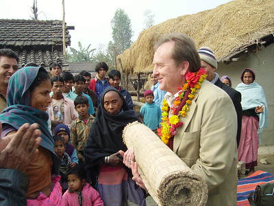 David Snell is gifted a tapestry during a visit to a Nepalese village