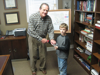 2010 03-16 Ronnie McBrayer presents David Snell with $12,000 check to build 4 houses in Haiti. Kirk Lyman-Barner