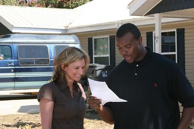 2011 03-18 Leonard Pope is briefed by Fuller Center VP of Communications Faith Fuller. ff