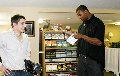 2011 03-18  Ryan Iafigliola gives Leonard Pope tour of Fuller Center office. ff