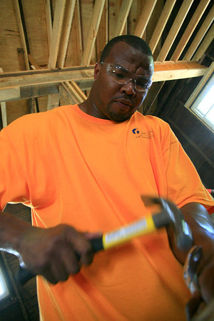 07-2011 Kansas City Chief tight end Leonard Pope gets to work on a Fuller Center construction site in Kansas City.