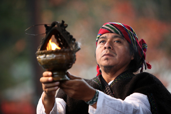 Nov 22: Genaro Jacinto Calel, a Mayan Priest from Guatemala, now living in Philadelphia offers a blessing to the crowds.   (Photo by Linda Panetta)