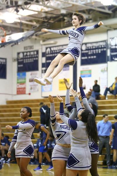 George P. Smith/The Montgomery Sentinel   <br /> Cheerleader flies high above the ground.