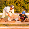 Conrad Kovalcik safely slides back to first on a throw from Giants catcher Trey Martinez to 1st baseman Nick Egli in the July 11, 2016 Cal Ripken summer league game between Rockville Express and Gaithersburg Giants, ©2016 Jacqui South Photography.