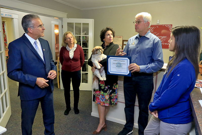 Medical Arts Hearing has 40 years of continuous operation in Leominster. The City honored them on Thursday with a citation for their many years. From left is Mayor Dean Mazzarella, North Central Ma. Chamber of Commerce ambassador Dottie Markham, owners Darrylin Besnilian-Wasiuk, tony Wasiuk and Leominster's Small Business Coordinator Melissa Tasca. The dog being held by Darrylin is Stella. SENTINEL & ENTERPRISE/JOHN LOVE