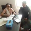 Dr. Ashokabhai's sister keeping record of patients