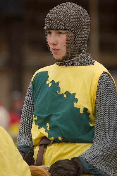 A young squire high on the horse, concentrated, but not overly worried.