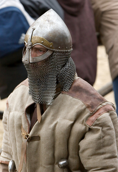 Like a veil, chain mail protects the lower face and the neck.  Being split on both sides improves movability.
