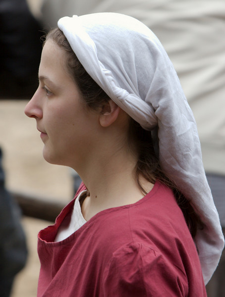 This young maiden has chastely hidden her main hair in white cloth