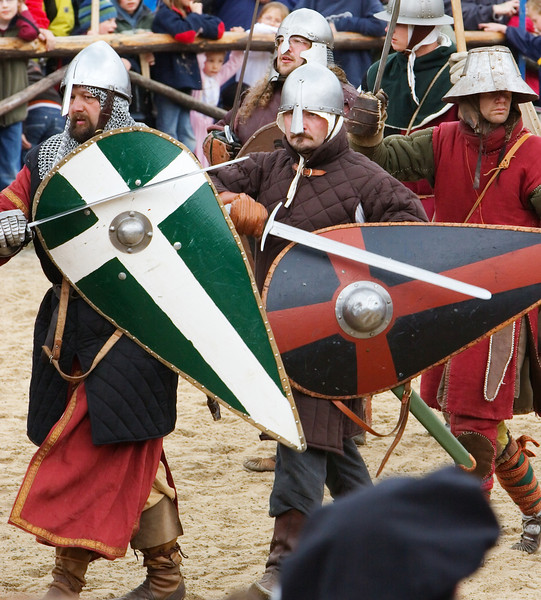 Beating their shields with their swords, this company shows that even after the end of the battle, they are prepared for any further scuffle and not afraid of anyone.