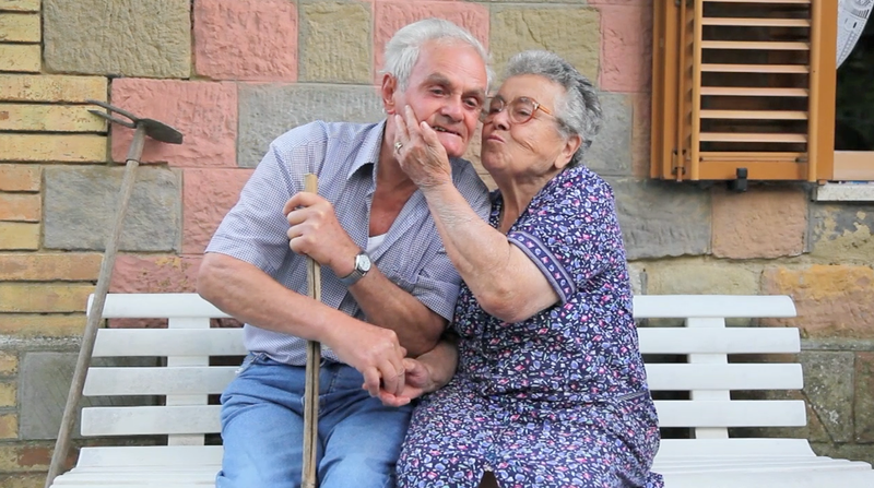 Sweet kiss of an old couple