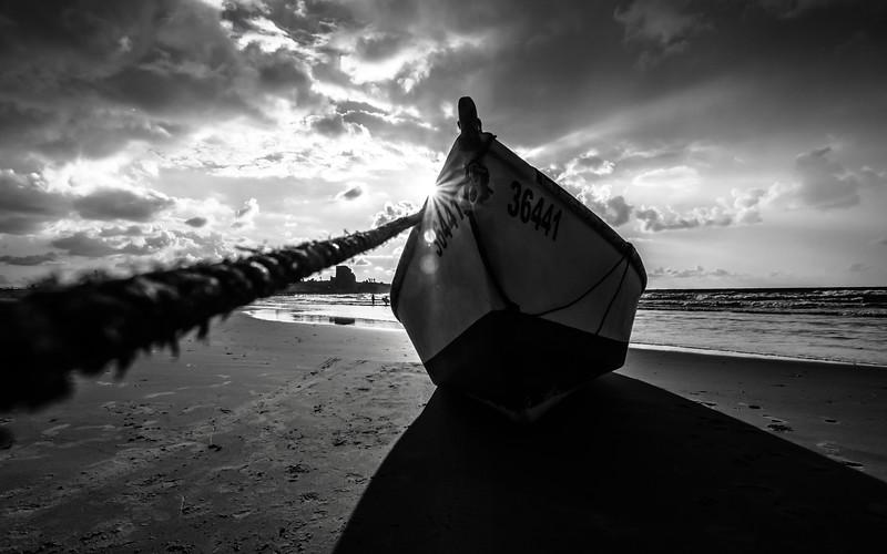 sunset black boat