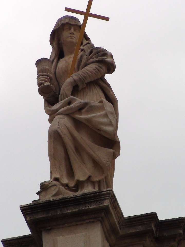 Another statue on top of the church