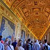 This hall has many maps which are tapestry wall hangings.  The ceiling has many different paintings and, since pictures cannot be taken in the Sistine Chapel, gives an idea of what it looks like.