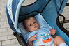 Baby-in-blue-carrier,-Durres,-Albania