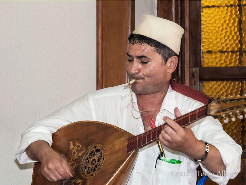 Musician-playing-laghouto,-Tirana,-Albania