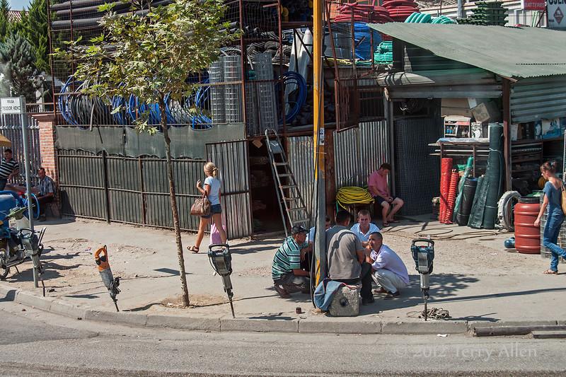 Men-at-'work'-with-idle-jack-hammers,-Tirana,-Albania