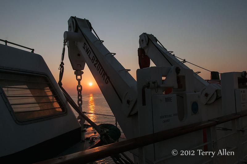 Ship's-lifeboat-&-davits-at-sunrise,-Adriatic-Sea