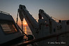 Ship's-lifeboat-&-davits-at-sunrise,-Adriatic-Sea