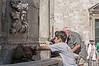Boy-getting-water-from-Onofrio-Fountain,-Dubrovnik,-Croatia