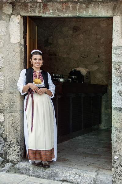 Young-Croatian-woman,-Ljuta-river-mill,-Croatia