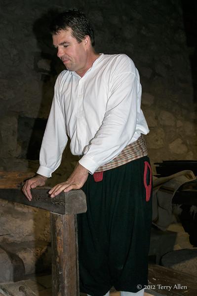 Miller-watching-corn-grinding,-Konavle-region,-Croatia