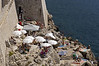 Sunbathing-&-swimming-by-city-walls,-Dubrovnik,-Croatia
