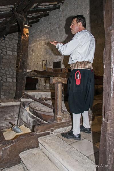 Miller-at-grinding-stone,-Ljuta-River,-Konavle-region,-Croatia