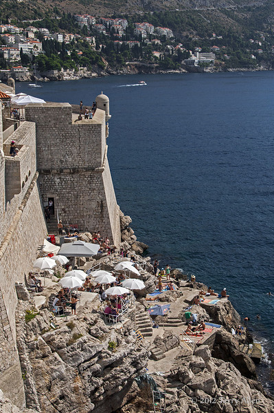Sunbathing-&-swimming-by-city-walls-2,-Dubrovnik,-Croatia