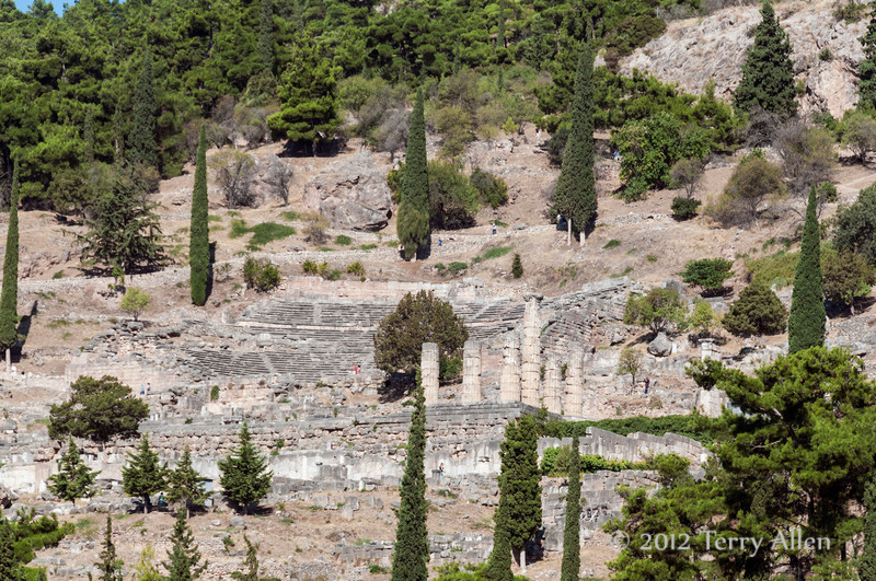 Ancient-Delphi,-theatre-and-Temple-of-Apollo-seen-from-below,-Greece