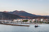 Itea-harbour-at-sunrise-with-pilot-boat,-Greece