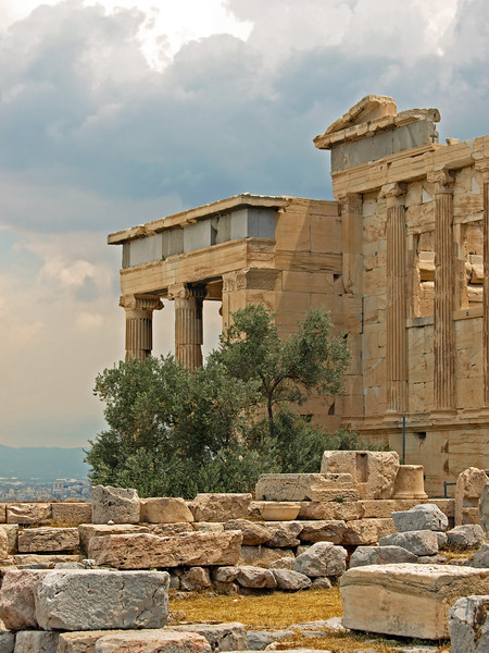 Ruins of the Acropolis and storm clouds approaching.